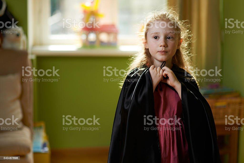 girl dresses black cape stock photo