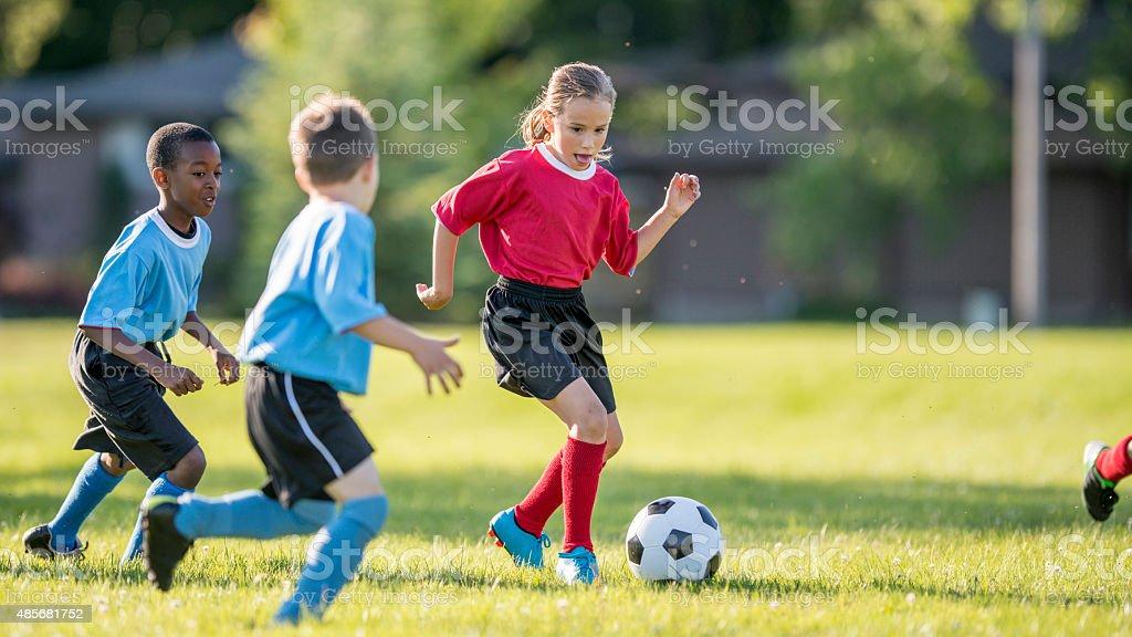 Girl Dribbling a Soccer Ball stock photo
