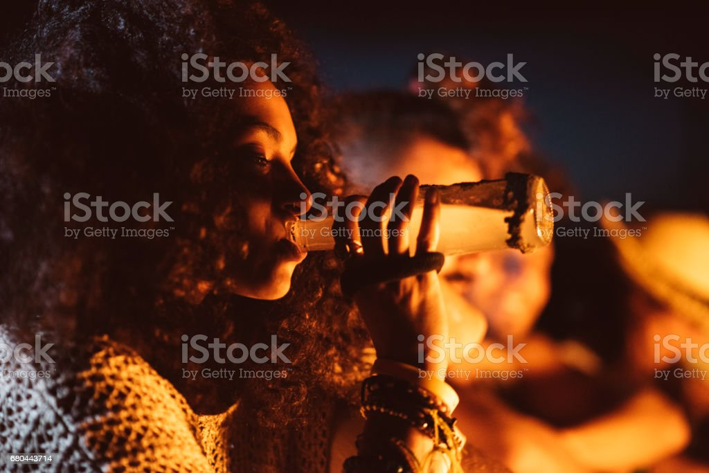 Girl drinking a beer stock photo