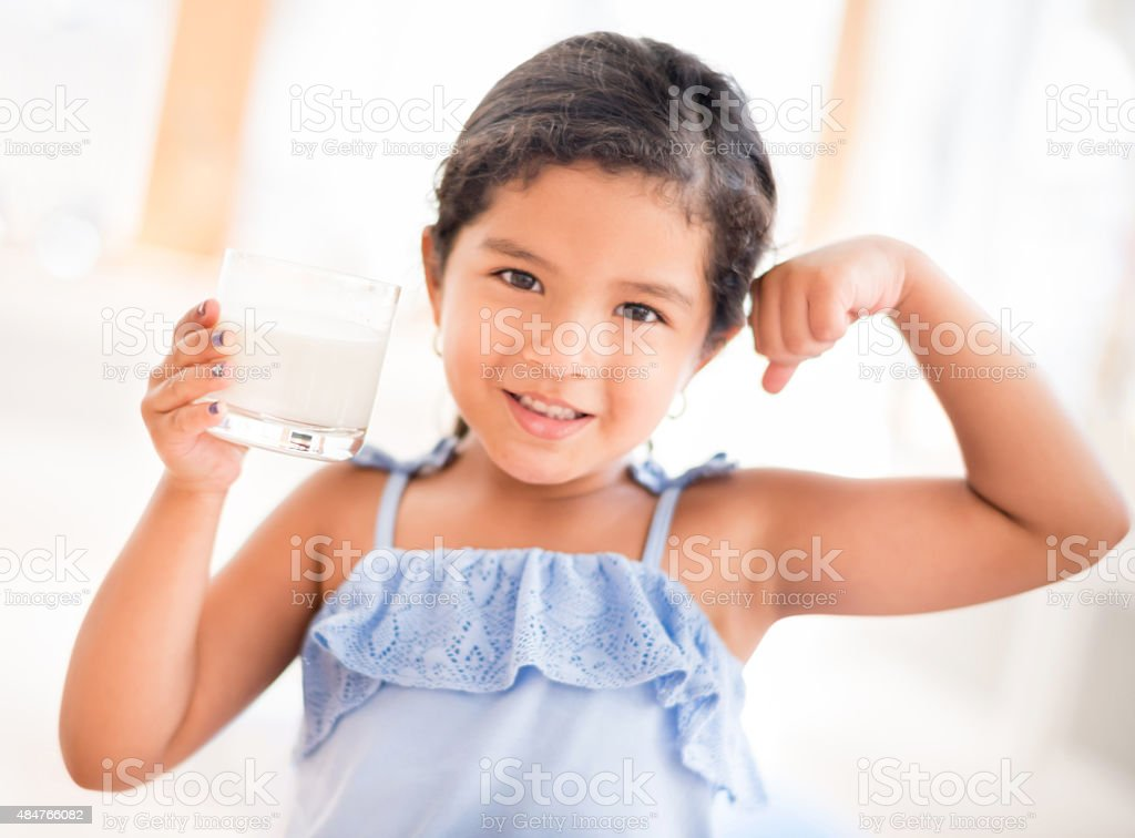 Girl drinking a glass of milk stock photo