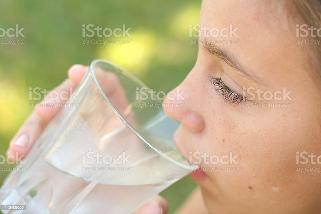 girl drinking a glass of water royalty-free stock photo