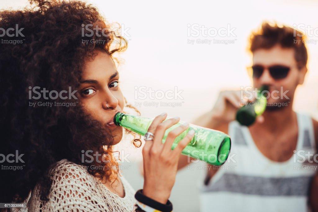 Girl drinking beer stock photo