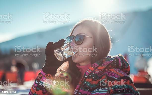 Girl drinking cocktail in ski resort picture id639811712?b=1&k=6&m=639811712&s=612x612&h=mzghox0jkkn1slqsbjjhdmgxuk0yx7dycaliuc2nriq=