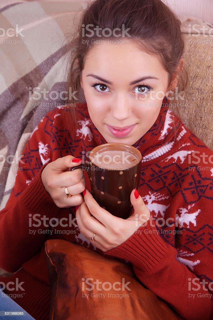 Girl drinking cocoa stock photo