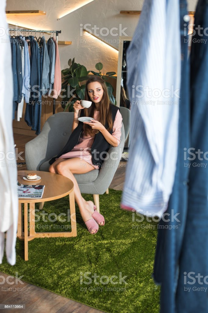 girl drinking coffee in boutique royalty-free stock photo