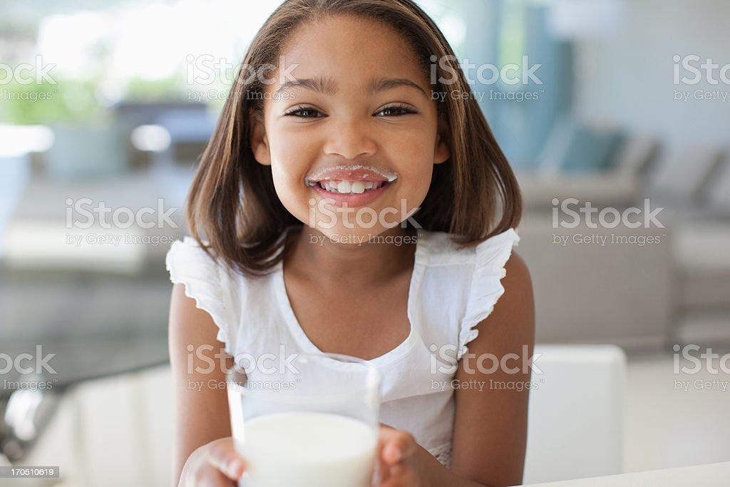 Girl drinking glass of milk stock photo