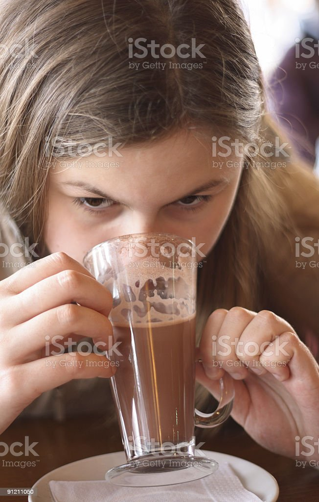 Girl drinking her coffee latte royalty-free stock photo