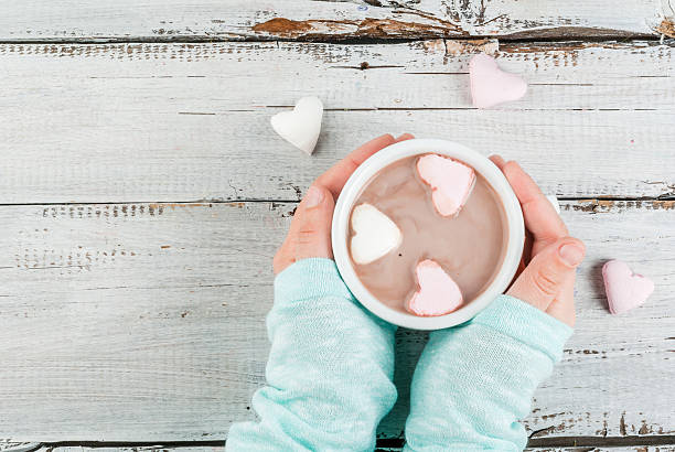 girl drinking hot chocolate with marshmallows's hearts - february stock photos and pictures