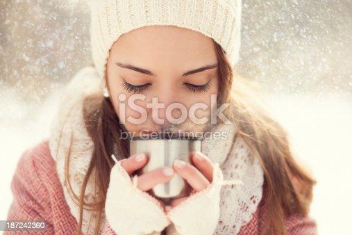 istock girl drinking hot tea in the winter 187242360