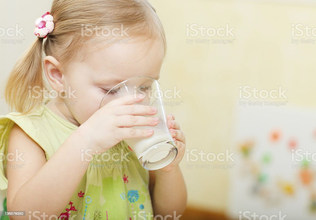 Girl drinking milk royalty-free stock photo