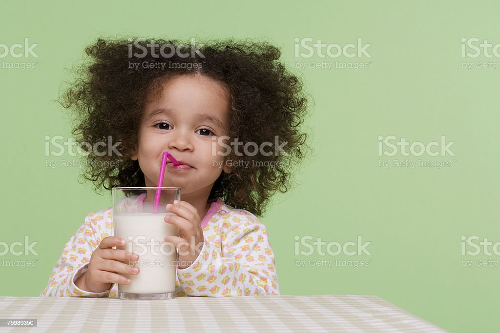 Girl drinking milk stock photo