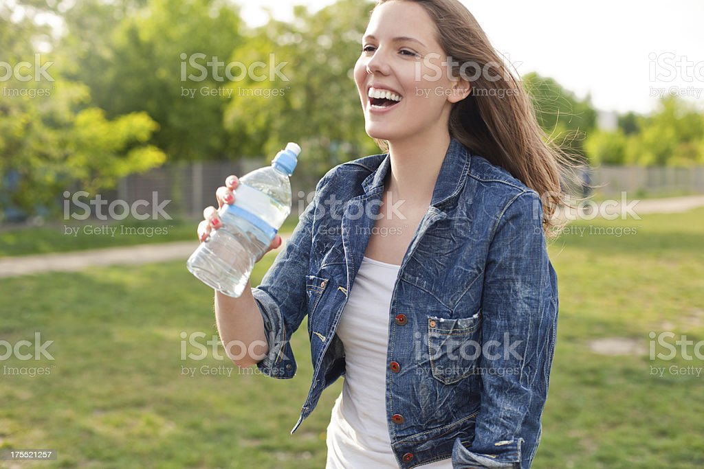 Girl drinking water at the park royalty-free stock photo