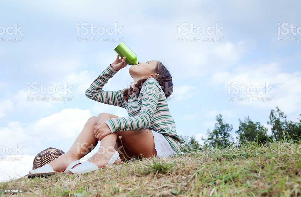 Girl drinking water royalty-free stock photo