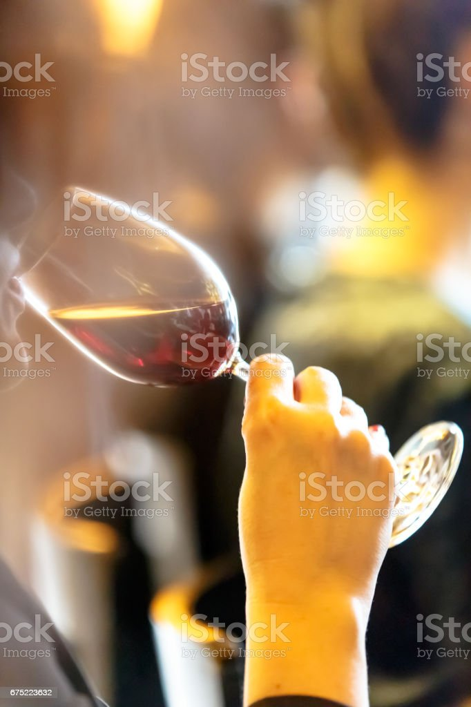 Girl drinks glass of red wine. royalty-free stock photo