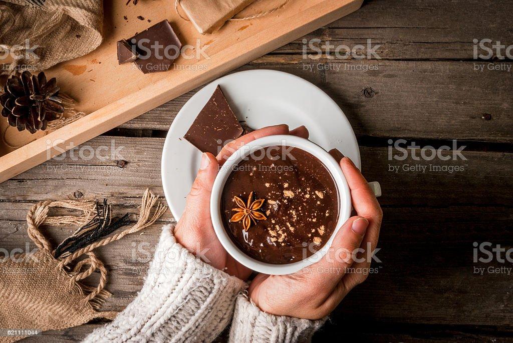 Girl drinks hot chocolate mug, with christmas present - foto de acervo