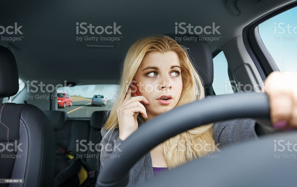 Girl driving a car having phone call royalty-free stock photo