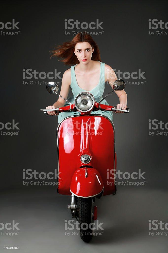 Girl driving motorbike stock photo