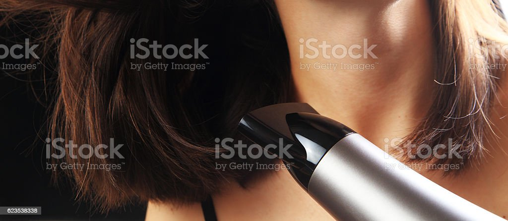 Girl dry hair with hairdryer stock photo