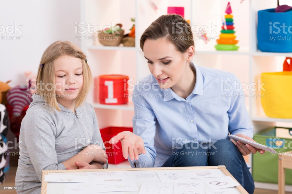 Girl during play therapy session stock photo