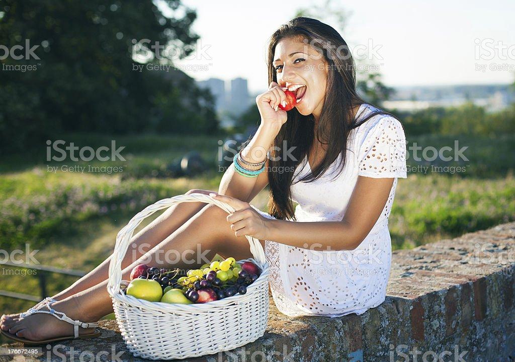 Girl eat fruit royalty-free stock photo