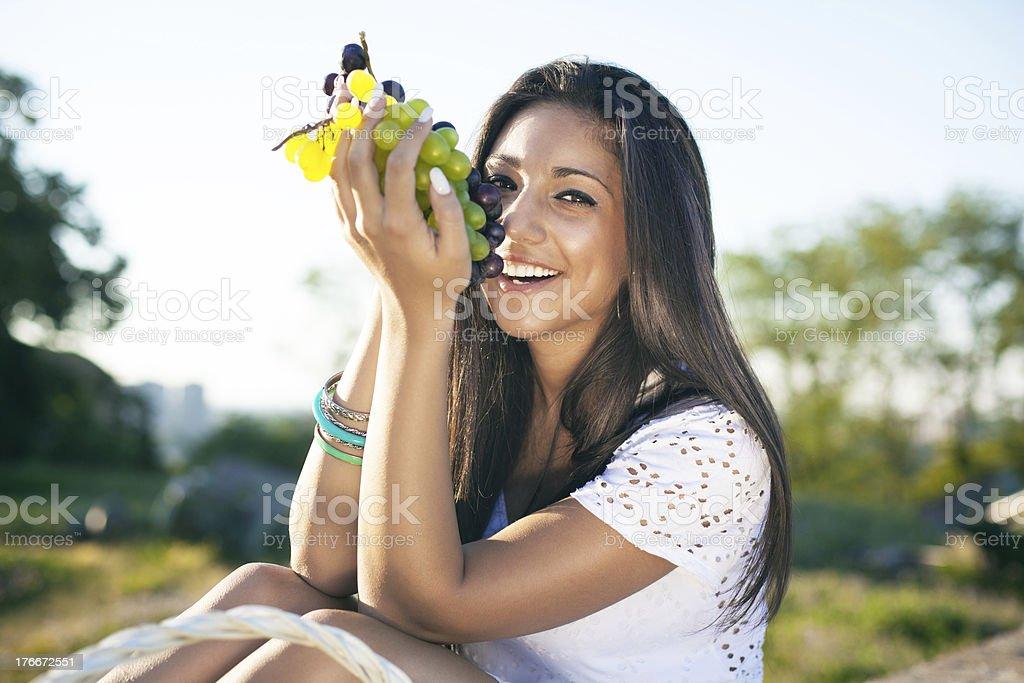Girl eat grape royalty-free stock photo