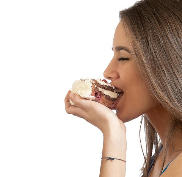 Girl eating a cake stock photo