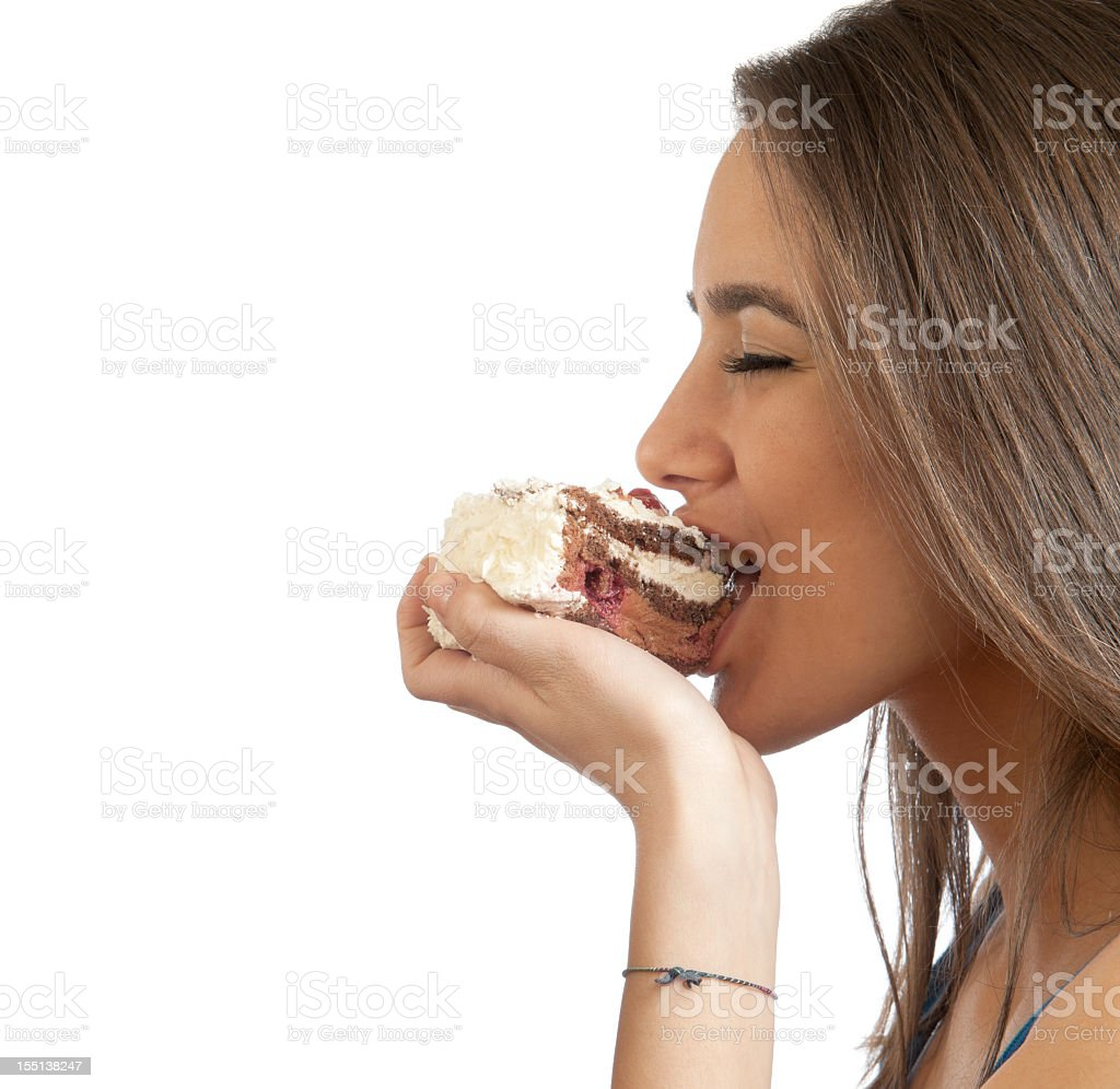 Girl eating a cake stock photo