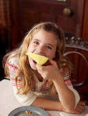 istock Girl eating a piece of cake 84751415