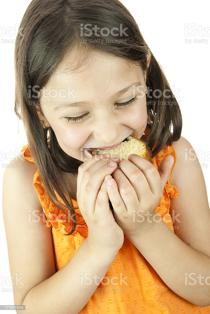 girl eating a slice of cake royalty-free stock photo