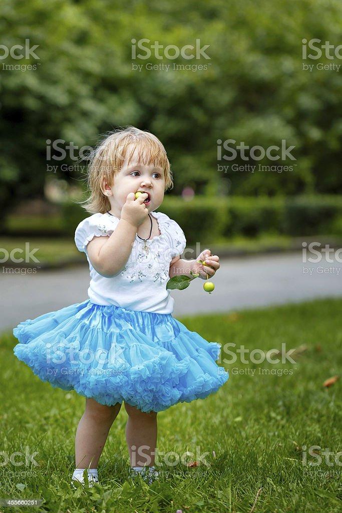 Girl eating an apple stock photo