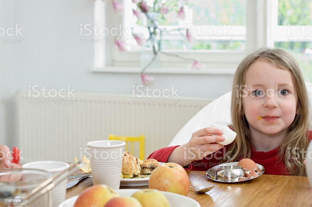 Girl eating an egg royalty-free stock photo