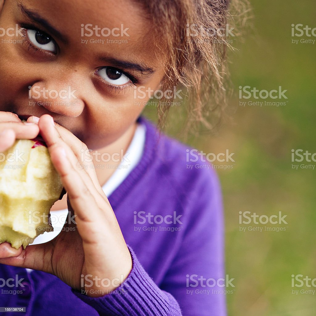 Girl eating apple stock photo