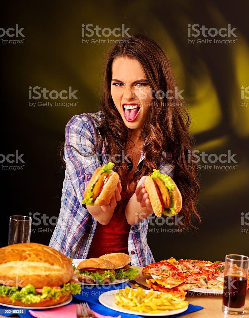 Girl eating big sandwich. stock photo