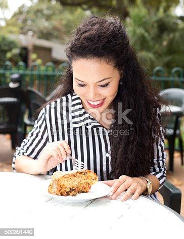 885959540 istock photo girl eating cake 502351440