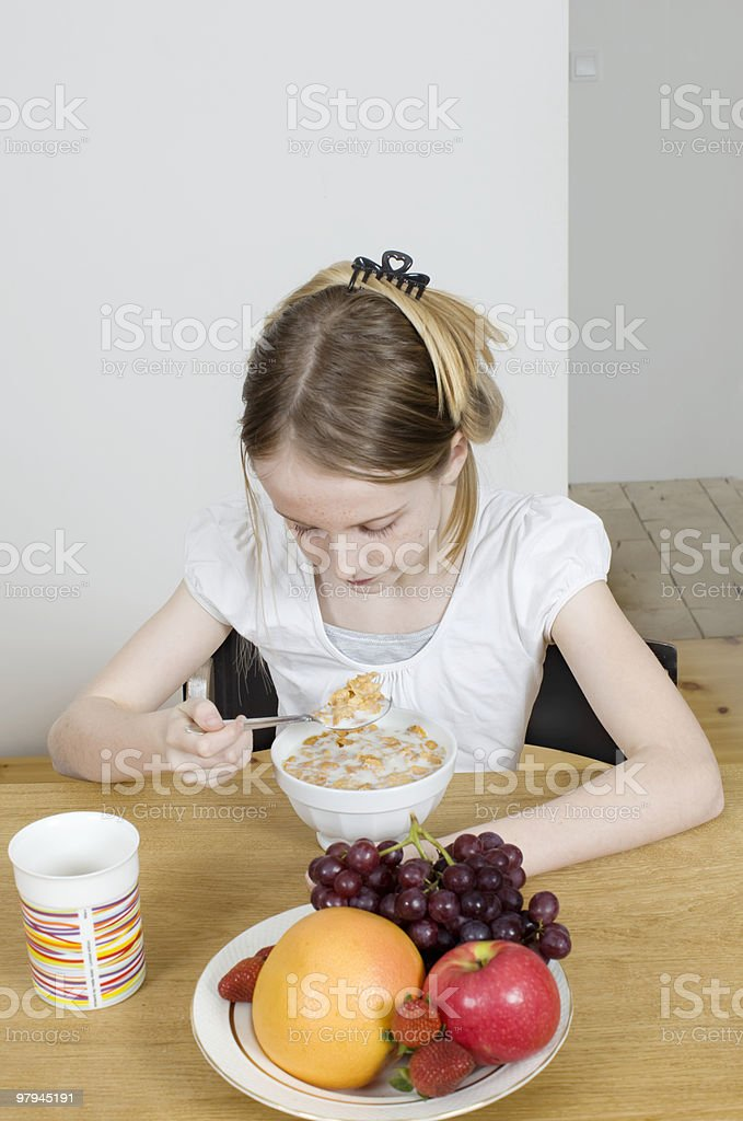 Girl eating cereals  royalty-free stock photo