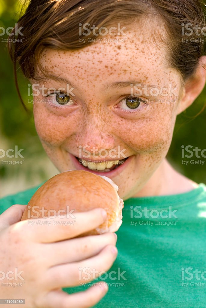 Girl Eating Donut Junk Food! royalty-free stock photo