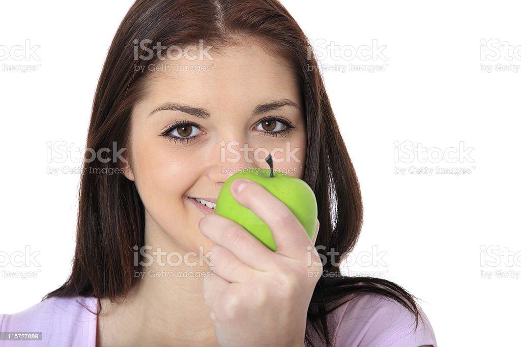 Girl eating green apple royalty-free stock photo