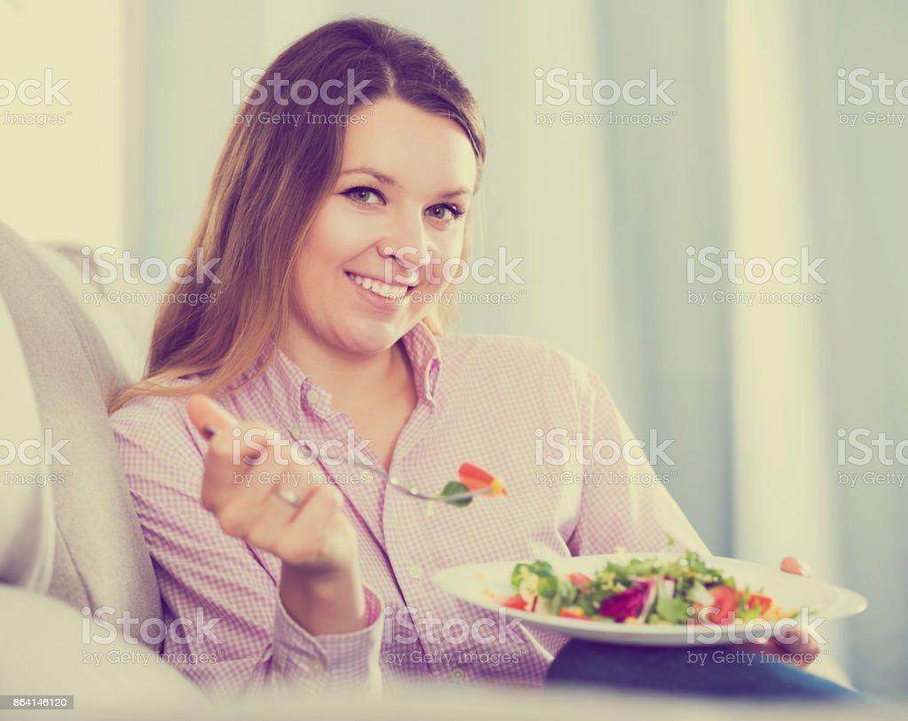 Girl eating green salad royalty-free stock photo