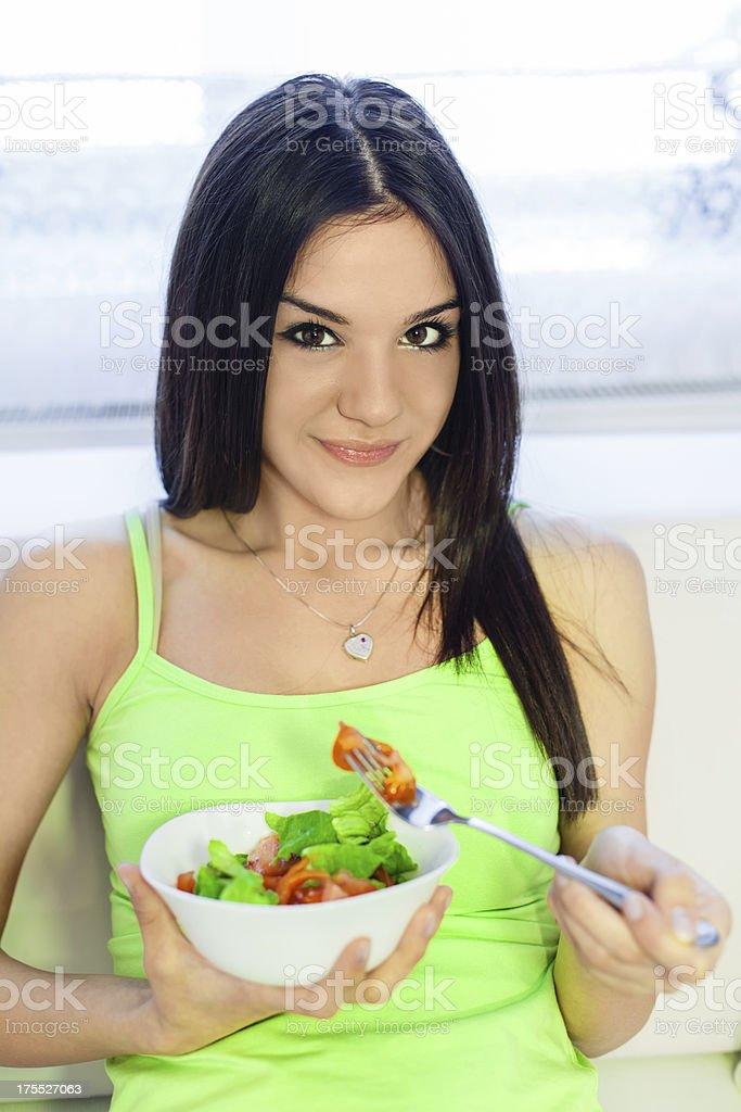 Girl eating healthy salad stock photo