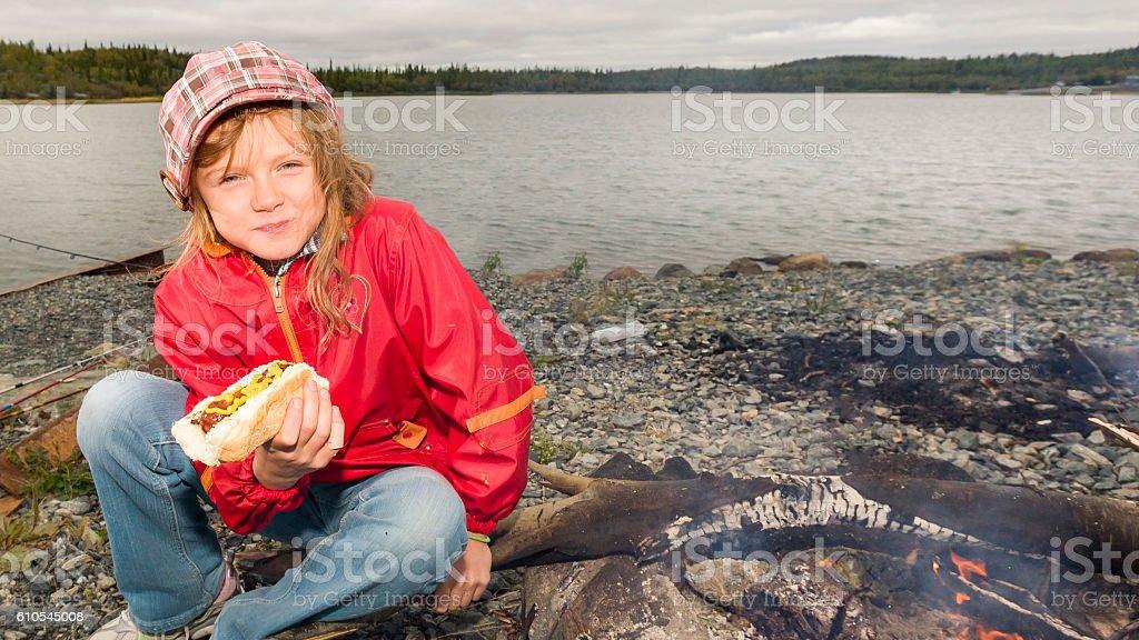 Girl eating hotdog stock photo