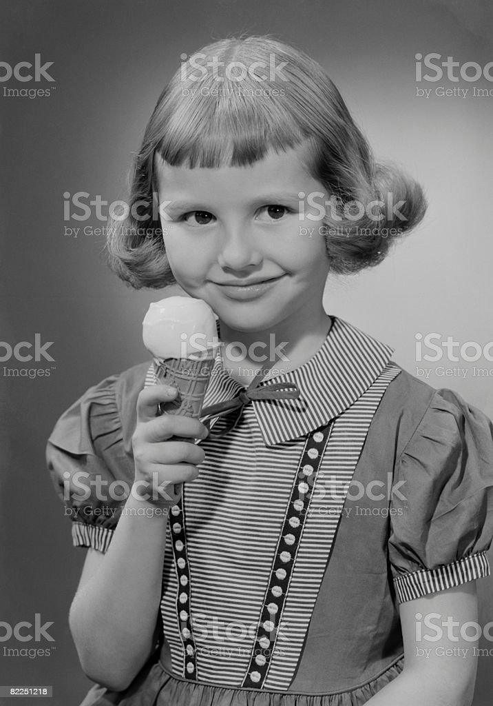 Girl (6-7) eating ice cream, portrait royalty-free stock photo
