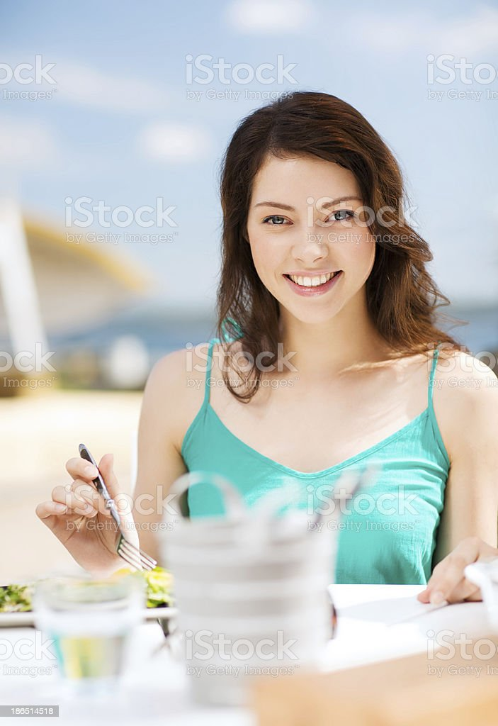 girl eating in cafe on the beach royalty-free stock photo
