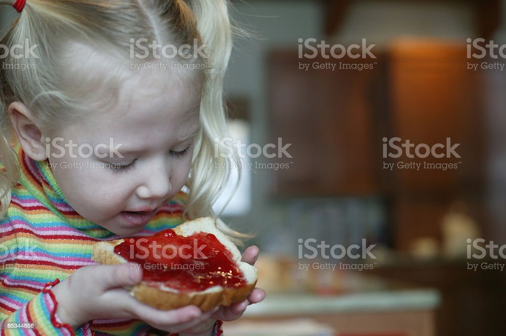 girl eating jelly sandwich royalty-free stock photo