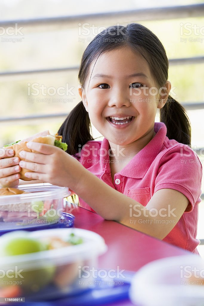 Girl eating lunch at kindergarten royalty-free stock photo