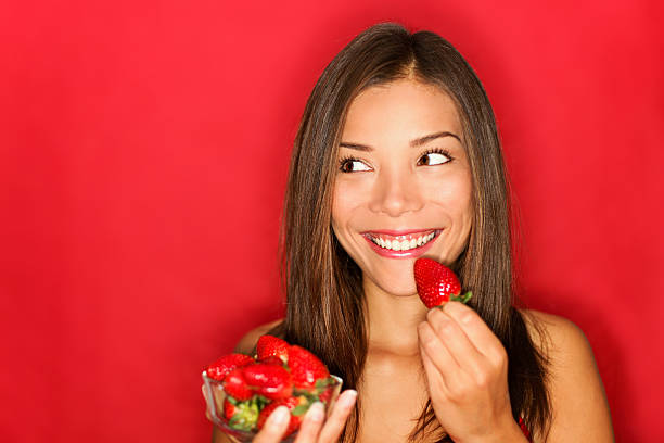 7e954a3a6214d Royalty Free Happy Healthy Eating Woman Hold Fruit Strawberry At ...