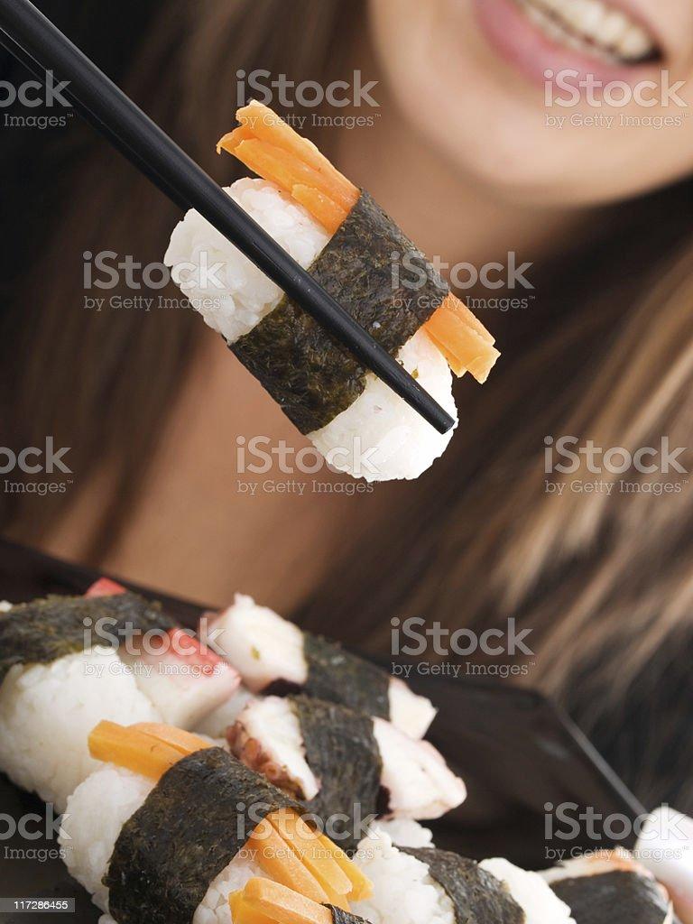 Girl eating sushi royalty-free stock photo