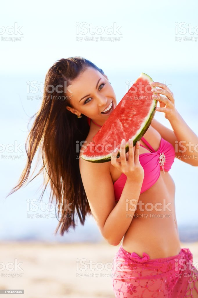 Girl eating watermelon at the beach royalty-free stock photo