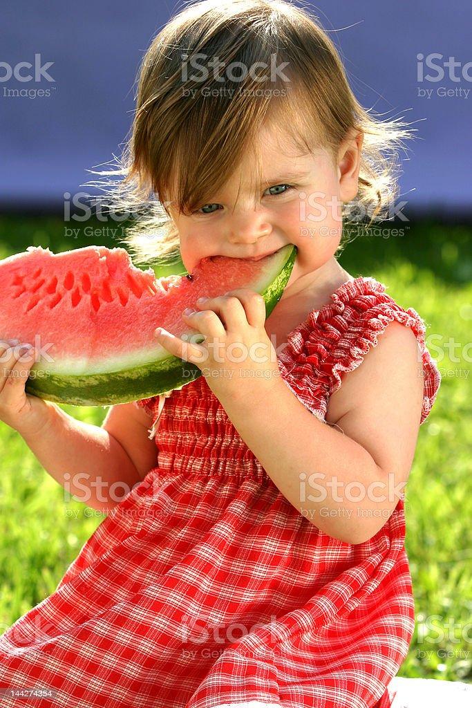 Girl eating watermelon royalty-free stock photo