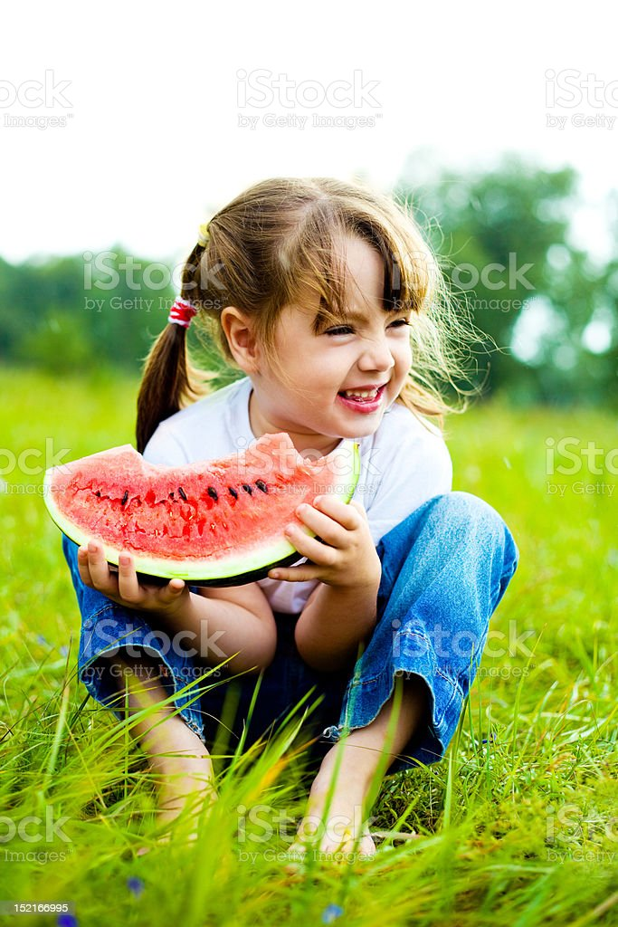 girl eating water-melon stock photo