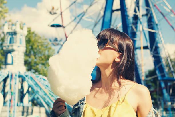 Girl eats cotton candy. stock photo